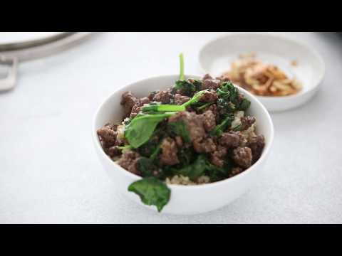 Thai Beef Bowl with fried garlic and spinach