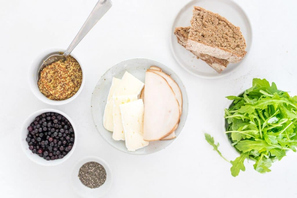 ingredients for turkey and brie sandwich on a table