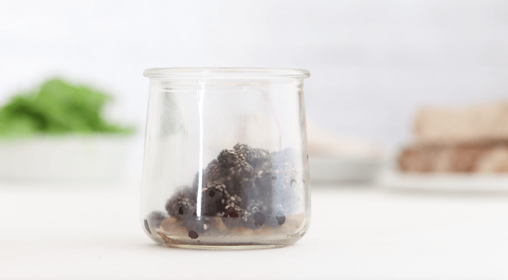 blueberries and whole grain mustard in a small glass jar