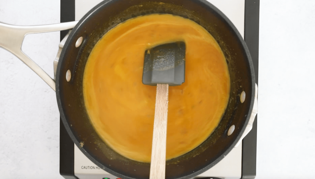 curry pumpkin soup cooking in black pot