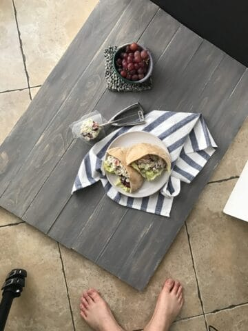 wooden photography board on the ground with props on top