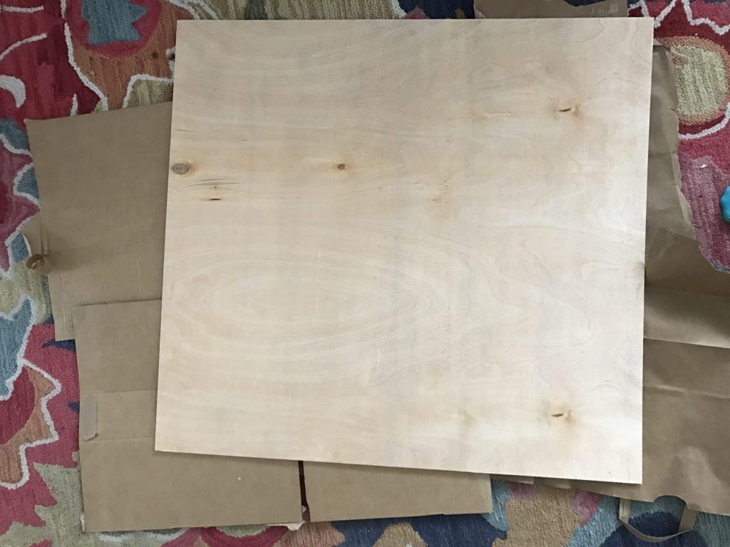 plywood board on carpet and cardboard ground