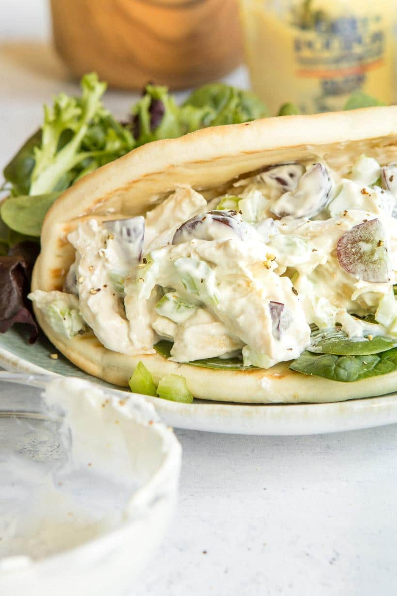 Close up of chicken Salad Pita Sandwich on a blue plate