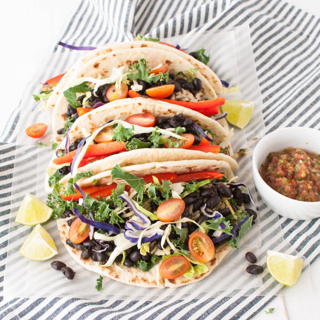 Black Bean Tacos with salsa on a striped towel