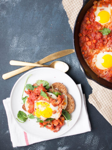 South African spiced Shakshouka on a white plate
