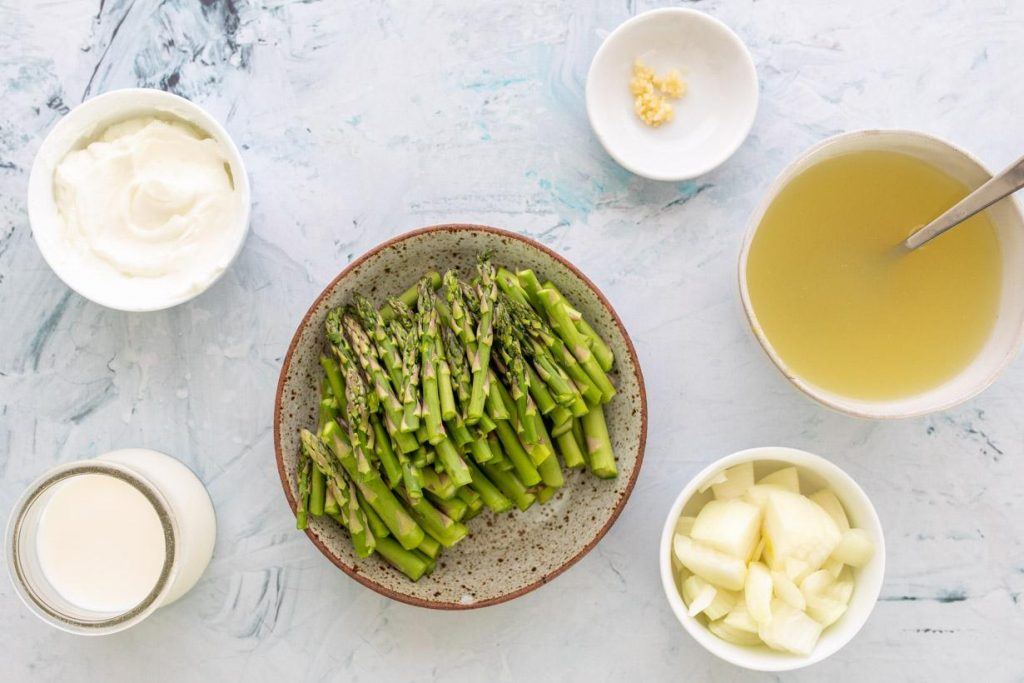 ingredients for creamy asparagus soup on a table