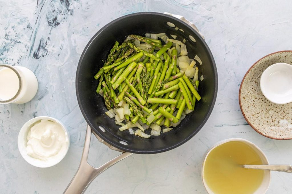asparagus and onions in a pan