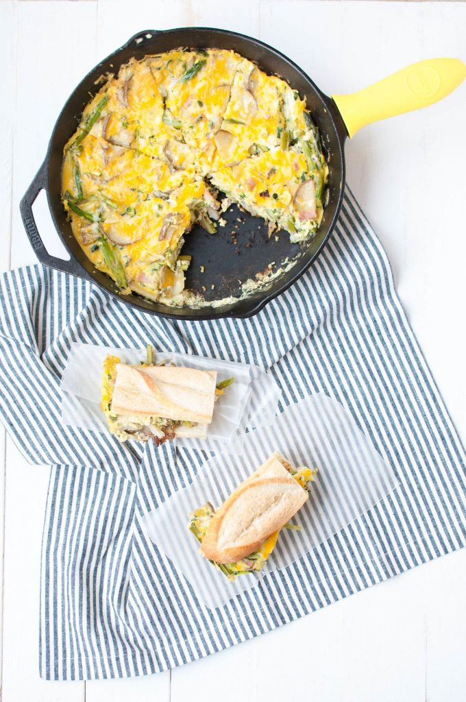 tortilla de patata on bread and in a skillet
