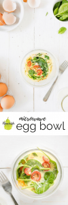 microwave egg bowl on a table with a fork, eggs, and spinach with text overlay
