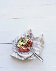 Microwave Scrambled Eggs with tomatoes in a glass bowl