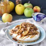 apple tart with apples on top and apples and yogurt in the background