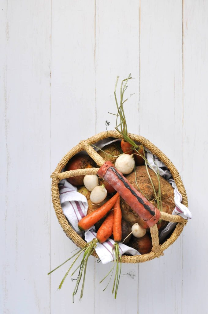 carrots, radishes, and celery root in basket