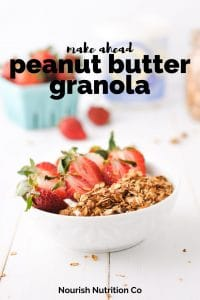 Peanut Butter Granola Pinterest-close up of granola on pan and granola, strawberries, and yogurt in bowl