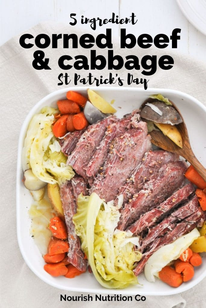corned beef and cabbage on a white serving platter with text overlay