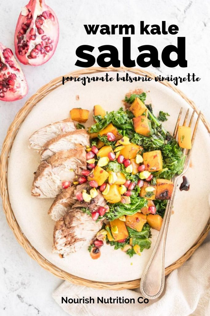 warm salad on a plate with pomegranate and text overlay