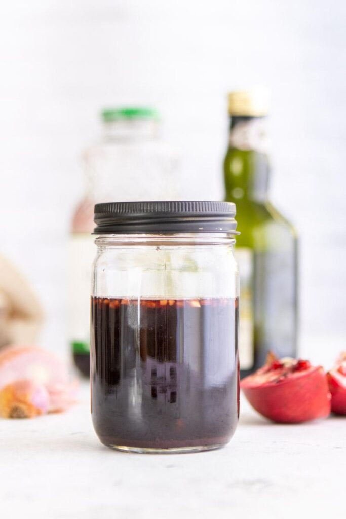 Pomegranate Balsamic Vinegar in a mason jar with ingredients in the background