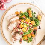 Warm Salad with Pomegranate Balsamic Marinated Pork Loin on plate