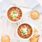 easy vegetarian chili in two bowls with cornbread