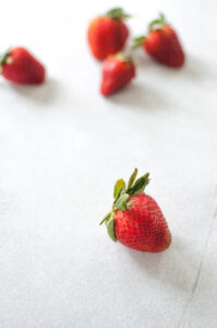 strawberries on concrete