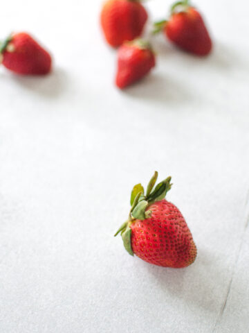 strawberries on concrete
