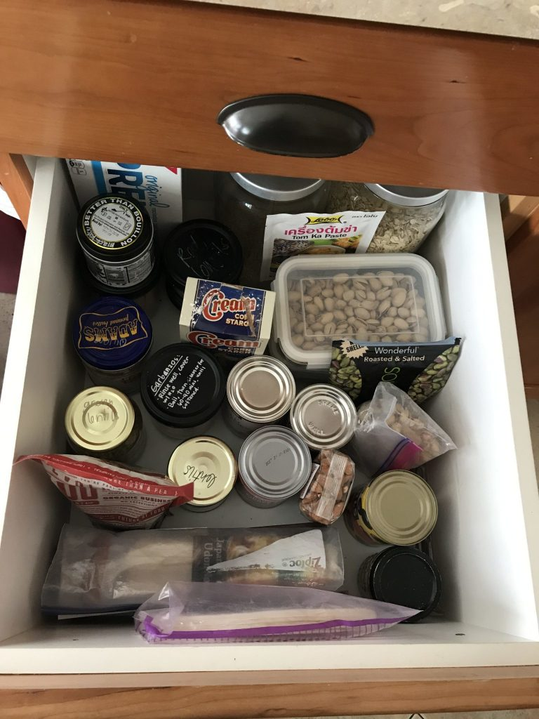 drawer with grains, nuts, beans, and pasta