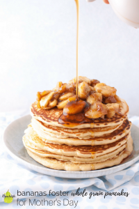 pouring maple syrup over bananas foster pancakes