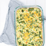 egg and sausage breakfast casserole in dish on a towel with text overlay