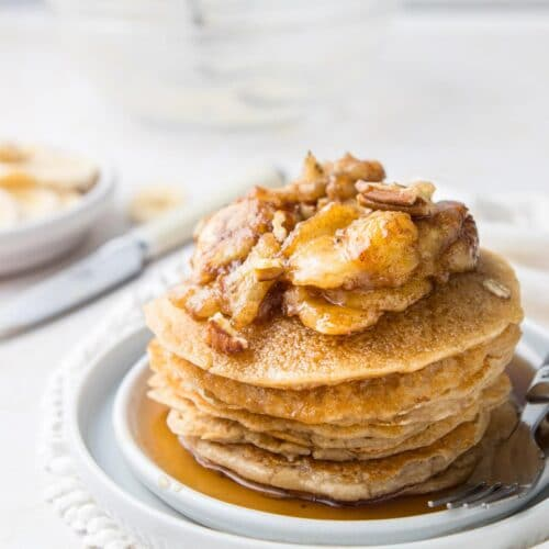 bananas foster pancakes on plate
