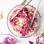 bowl of red wine vinegar coleslaw with ingredients on the side