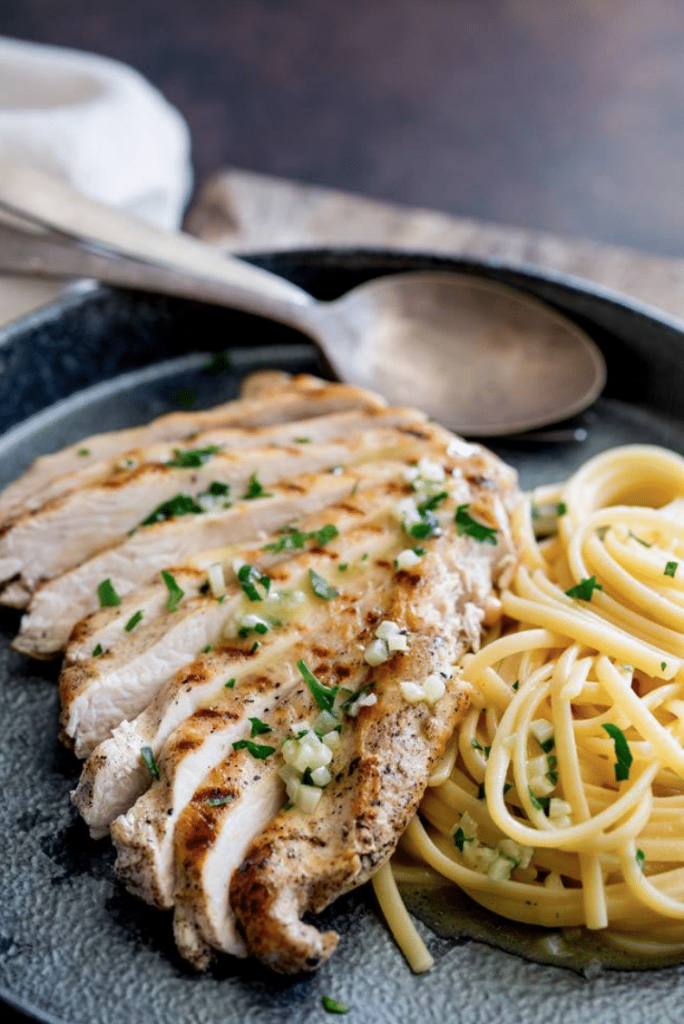 chicken and pasta on black plate
