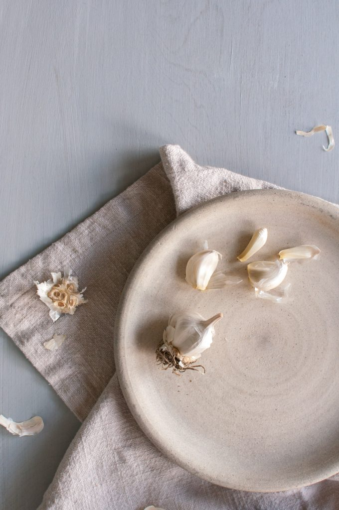 artistic photograph of garlic on a plate