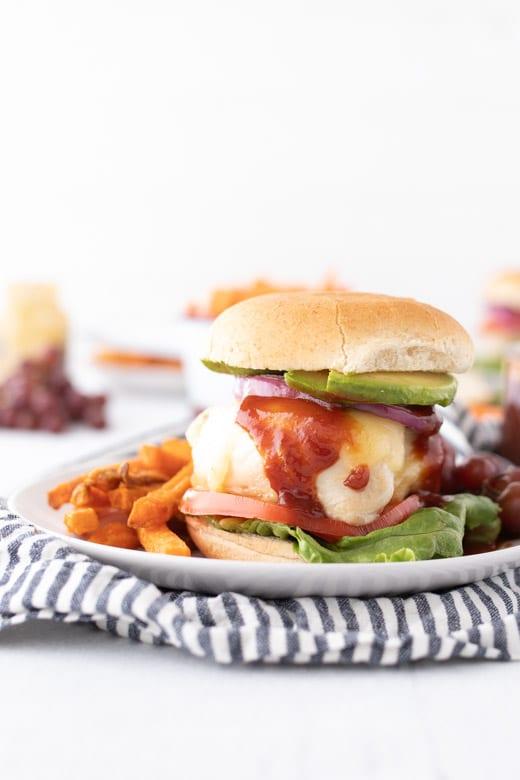 side shot of assembled grilled chicken burger