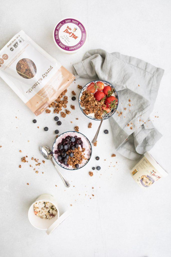 overhead shot of yogurt with granola and muesli