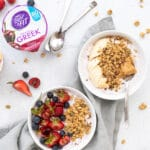 easy yogurt bowls with fruit and cartons of yogurt