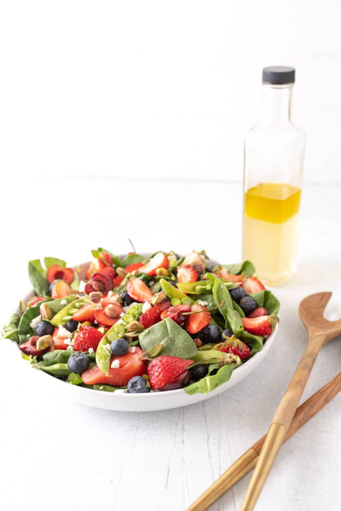 summer berry salad with homemade dressing on side