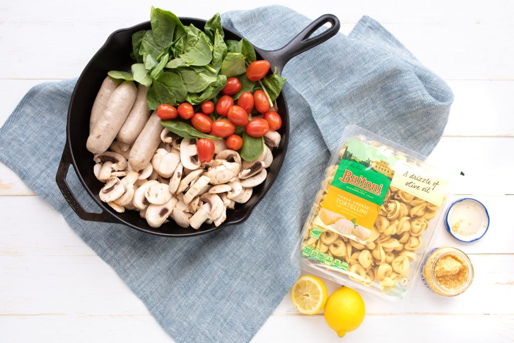 ingredients for easy tortellini with sausage on a table