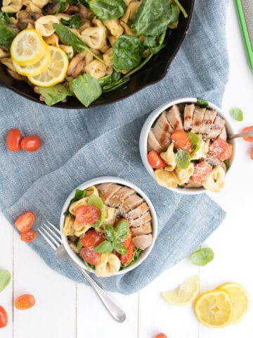 easy tortellini with sausage in bowls