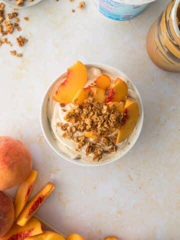 PB Greek yogurt dip with Dannon Light & Fit yogurt cup, apples, and graham crackers on table