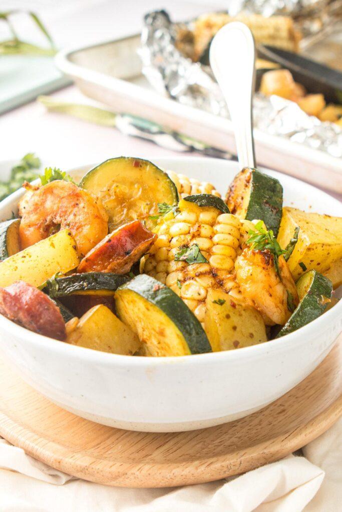 cajun shrimp & vegetables in a white bowl