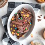 easy dark chocolate halloween candy bark with quinoa on pan with ingredients on table
