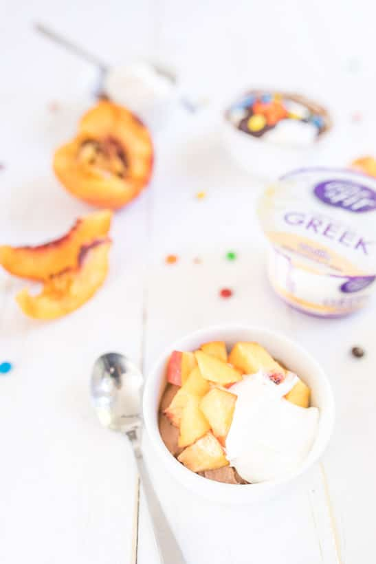 quick protein packed chocolate pudding with peaches on table