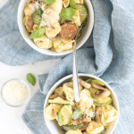 sausage and artichoke tortellini with text overlay