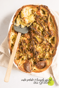 rustic potato and brussels sprouts au gratin in pan with text overlay