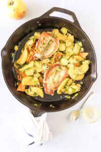 easy skillet pork chops with vegetables in a cast iron skillet