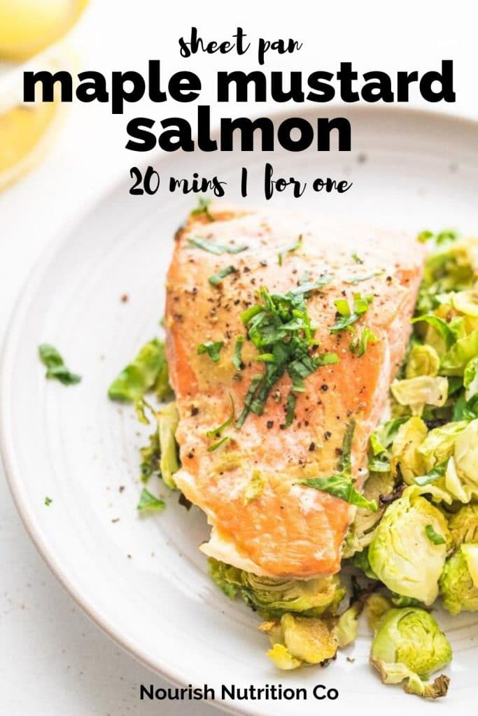 maple mustard salmon and brussels sprouts with a lemon wedge on a plate with text overlay