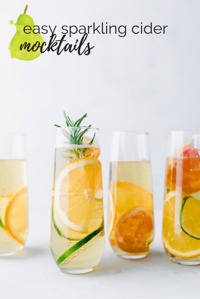 four apple mocktails in stemless champagne glasses with citrus and rosemary and a text overlay