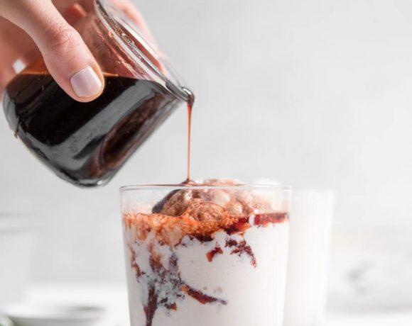 frozen greek yogurt with tart cherry sauce in a cup