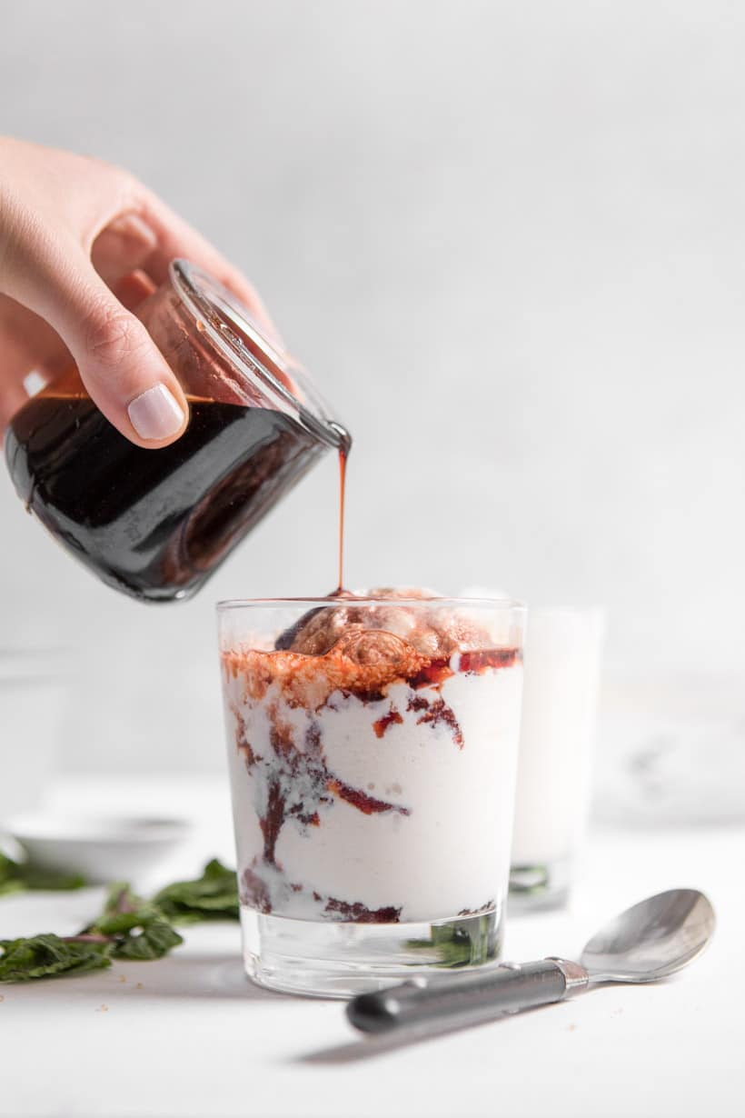 frozen greek yogurt with tart cherry sauce in a cup