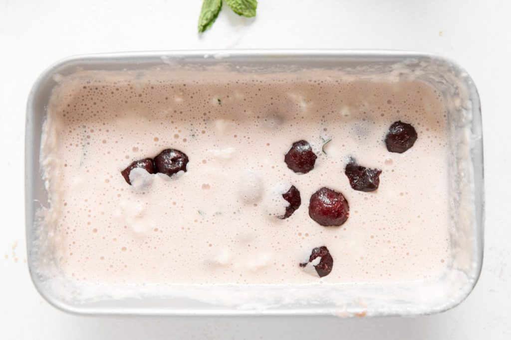 frozen greek yogurt with cherries in a loaf pan