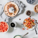 waffles and toppings on a table for DIY waffle bar